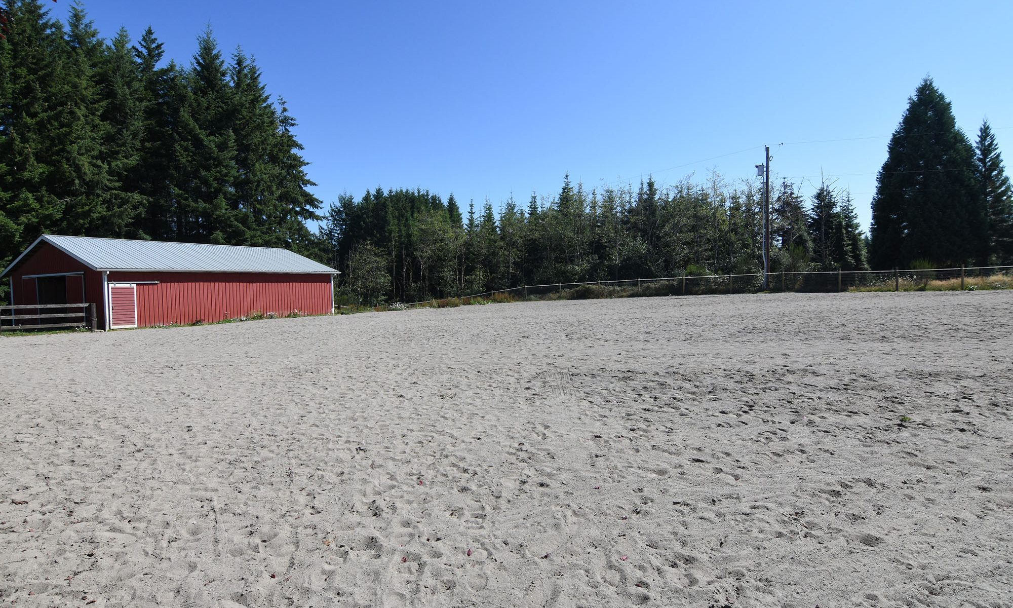 Copper Creek Farm outdoor sand arena in Rainier Oregon