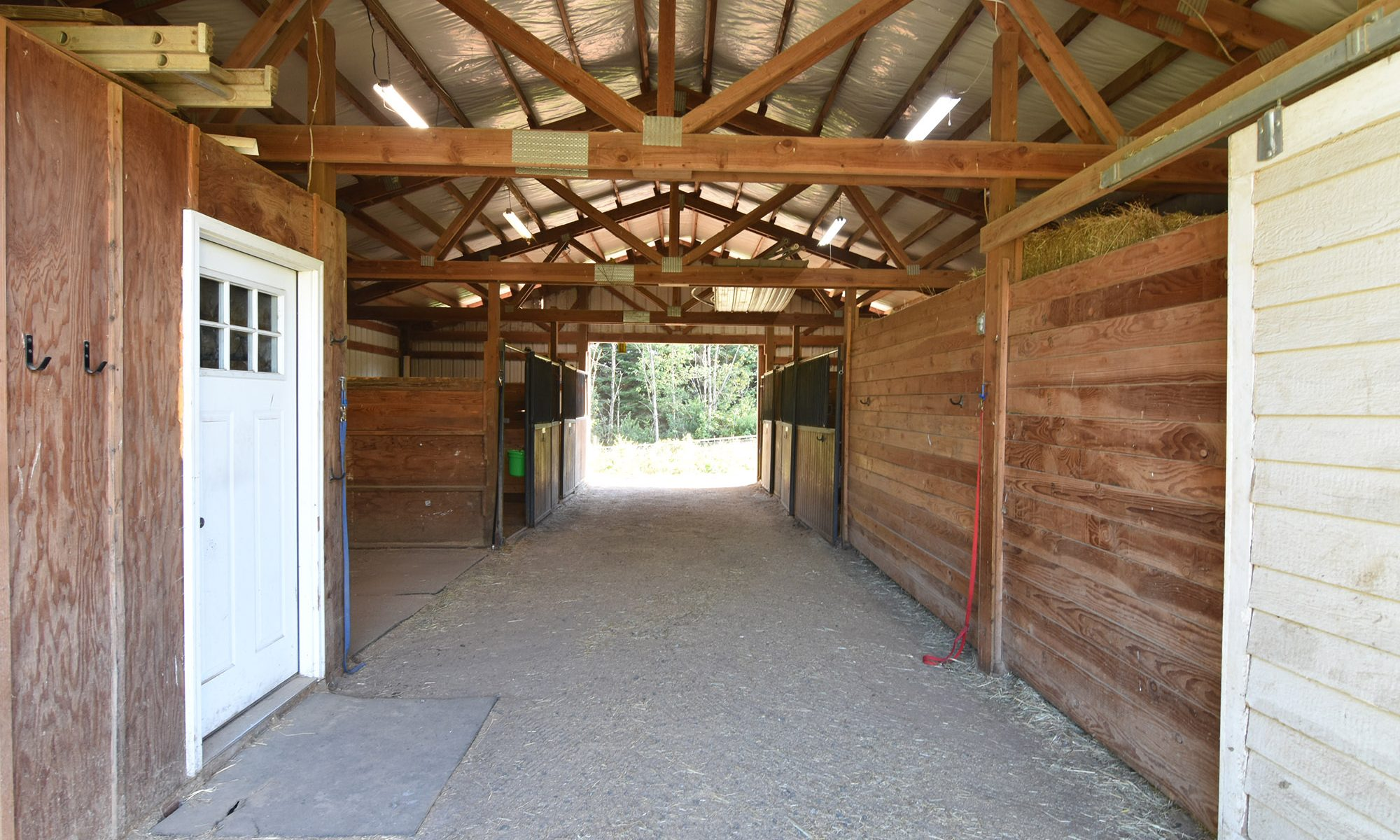 Inside of a 4 stall barn with tack room and feed room